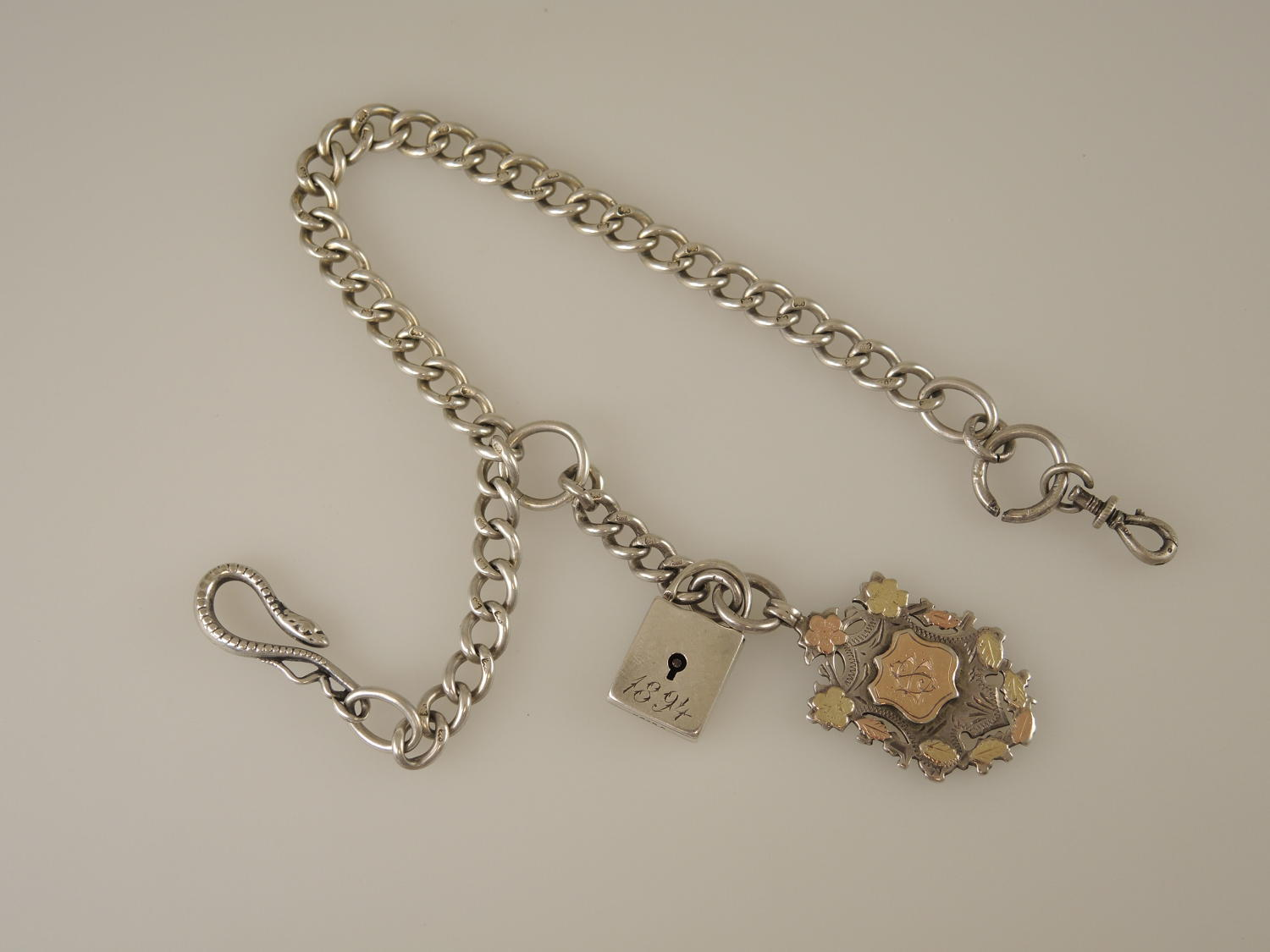 English silver watch chain with unusual fobs and Snake hook c1900