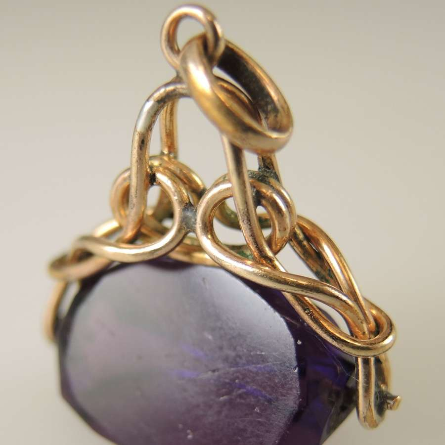 Gilt metal and Amethyst Swivel Fob c1890
