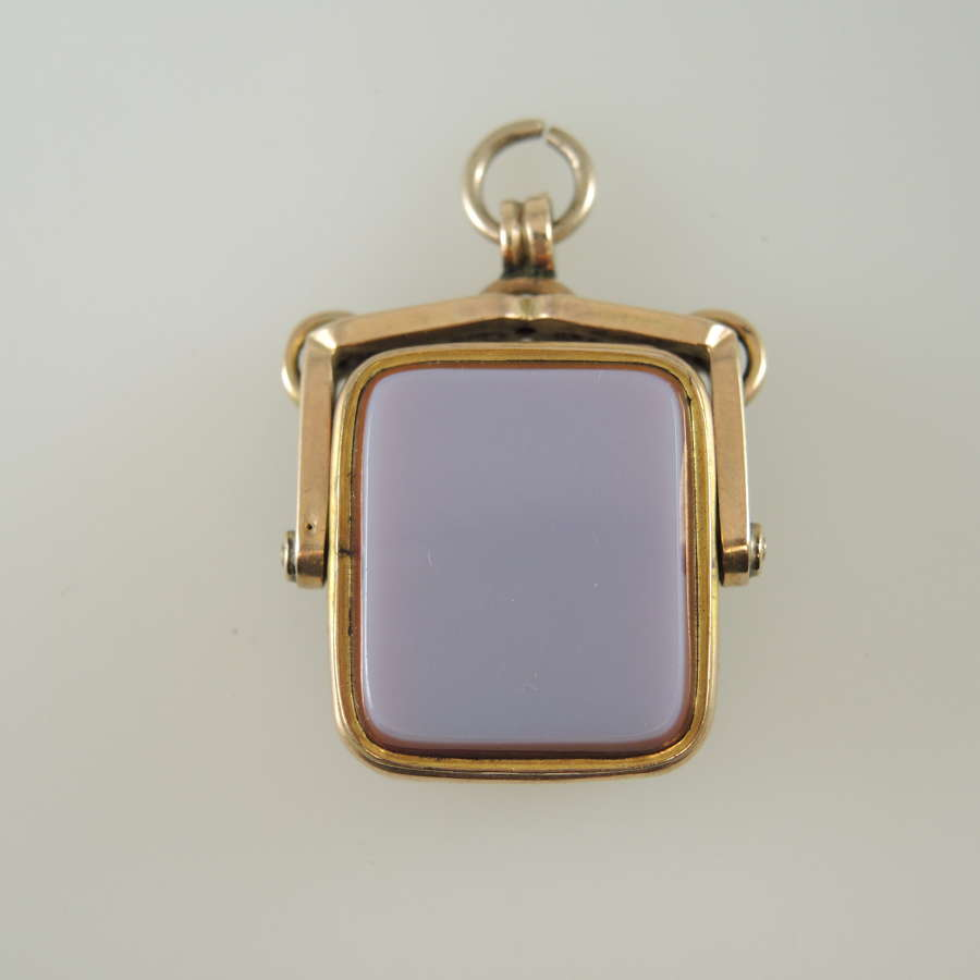 Gilt stone set Swivel Fob locket c1890